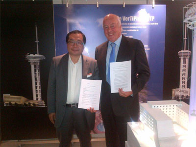 Brian Pettifer and Mr Xiao holding signed MOUs for the proposed international pilgrimage and tourism development at Lumbini, Nepal – the birthplace of the Lord Buddha
